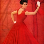 Anne Gunning wearing a dress by Mollie Parnis 1957
