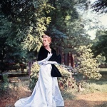 Model wearing gown by Ben Reig stole by Revillon 1954