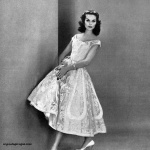 Anne St Marie wearing a dress by Ceil Chapman 1956