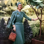 Sunny Harnett wearing suit by Davidow Spring Collection 1958